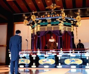 TOKYO, Oct. 22, 2019 - Japanese Emperor Naruhito (C) and Prime Minister Shinzo Abe (L) attend the emperor's coronation ceremony in the Seiden State Hall at the Imperial Palace in Tokyo, Japan, Oct. ...