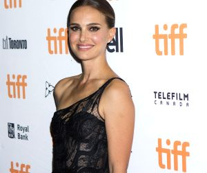 """TORONTO, Sept. 12, 2019 - Actress Natalie Portman poses for photos before the world premiere of the film """"Lucy in the Sky"""" at Princess of Wales Theatre during the 2019 Toronto International ..."""