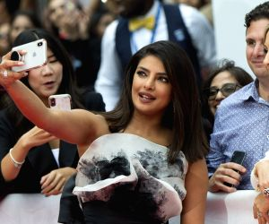 Actress Priyanka Chopra Jonas takes selfies with fans during the 2019 Toronto International Film Festival (TIFF)