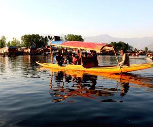 Tourists enjoy a Shikara ride on Dal Lake