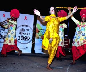Transgenders perform on World AIDS Day eve