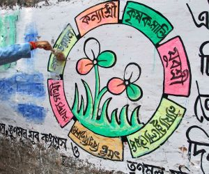 Sovandeb Chatterjee cleans a graffiti after assembly elections