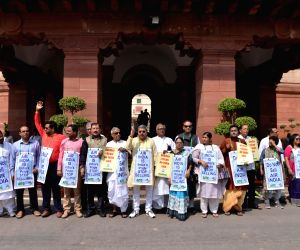 Trinamool Congress (TMC) MPs stage a demonstration against disinvestment in Air India at Parliament in New Delhi, on April 2, 2018.
