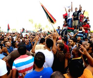 Local citizens wave flags and chant slogans in the streets