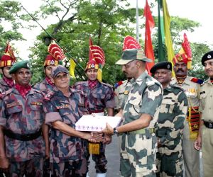 Tripura: Soldiers of Border Security Force (BSF) and Border Guards Bangladesh (BGB) exchange greetings and sweets on the eve of Eid-Ul-Fitr at Akhuara land port and immigration centre, in the Agartala-Brahminbaria border of Tripura on June 4, 2019. (