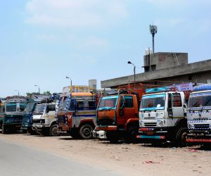 All-India truck, bus strike - Trucks remain parked at a depot