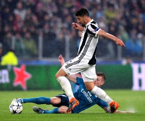 TURIN, April 4, 2018 - Real Madrid's Toni Kroos (Bottom) vies with Juventus' Sami Khedira during the UEFA Champions League quarterfinal first leg soccer match between Juventus and Real Madrid in ...