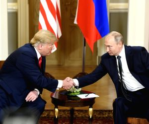 Putin hails summit with Trump, slams critics