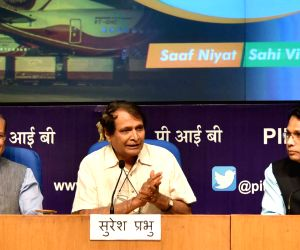 Union Civil Aviation Minister Suresh Prabhu along with Union MoS Civil Aviation Jayant Sinha and PIB DG Sitanshu R. Kar, addresses a press conference on the achievements of the Ministry of ...