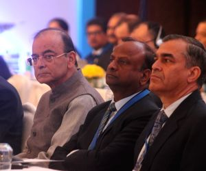 Union Finance Minister Arun Jaitley, State Bank of India (SBI) Chairman Rajnish Kumar, and National Bank for Agriculture and Rural Development (NABARD) Chairman Harsh Kumar Bhanwala at the ...