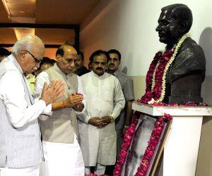Advani, Rajnath pay tribute to S P Mukherjee