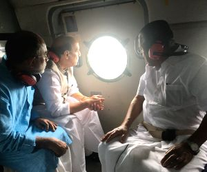 Union Home Minister Rajnath Singh along with Kerala Chief Minister Pinarayi Vijayan and Union Culture and Tourism Minister Alphons Kannanthanam, conducting the aerial survey of flood affected ...