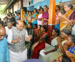 Union Home Minister Rajnath Singh along with Kerala Chief Minister Pinarayi Vijayan and Union Culture and Tourism Minister Alphons Kannanthanam visit a flood relief camp in Ernakulam, ...