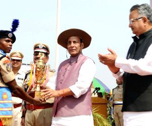 Union Home Minister Rajnath Singh presents trophies, during the Passing Out Parade of the 'Bastariya Battalion' of CRPF in Ambikapur, Chhattisgarh on May 21, 2018. Also seen ...