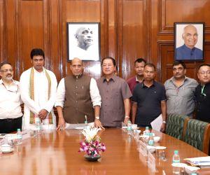 Union Home Minister Rajnath Singh, Tripura Chief Minister Biplab Kumar Deb and Mizoram Chief Minister Pu Lalthanhawla, Union Home Secretary Rajiv Gauba and senior officers of MHA and ...