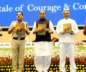 Union Home Minister Rajnath Singh unveils table book titled 'A tale of Courage and Compassion', at the Investiture Ceremony of Border Security Force (BSF), in New Delhi on May 22, ...