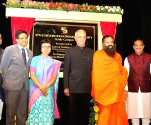 Union Human Resource Development Minister Ramesh Pokhriyal 'Nishank', Yoga Guru Baba Ramdev and Symbiosis International University Chancellor S. B. Mujumdar during the inauguration of the ...