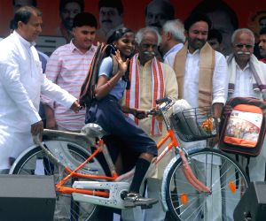 Bandaru Dattatreya distributes bags and cycles to school students