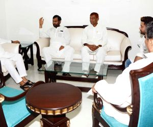 Union Minister and LJP Chief Ram Vilas Paswan accompanied by his son and party leader Chirag Paswan meet Bihar Chief Minister Nitish Kumar, in Patna on Aug 12, 2018.
