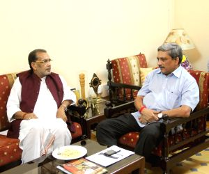 Union Minister for Agriculture Radha Mohan Singh discussing issues with Goa CM Manohar Parrikar during his visit at Goa CMs Official Residence at Altinho Panaji on August 2, 2014.