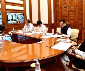 Union Minister for Finance and Corporate Affairs Arun Jaitley chairs the 27th GST Council Meeting via video conference in New Delhi on May 4, 2018. Also seen Finance Secretary cum Revenue ...