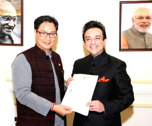 Kiren Rijiju presents the Certificate of Indian Citizenship to Adnan Sami