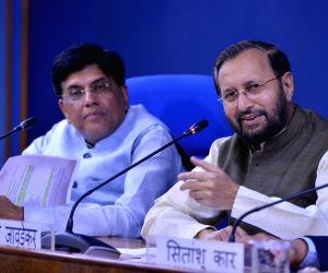 Union Ministers Prakash Javadekar and Piyush Goyal address a press conference in New Delhi on July 17, 2019.