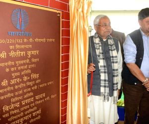 Union MoS Power and New and Renewable Energy Raj Kumar Singh and Bihar Chief Minister Nitish Kumar unveil the plaque to inaugurate a power sub-station in Parmanandpur village of Bihar's ...
