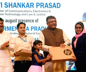 Union Petroleum and Natural Gas and Steel Minister Dharmendra Pradhan and Electronics and Information Technology and Law and Justice Minister Ravi Shankar Prasad during Common Service ...
