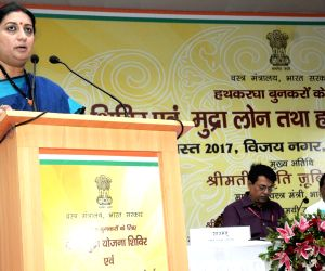 Smriti Irani distributes MUDRA loan Certificates to weavers