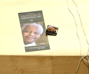 UNITED NATIONS, July 18, 2019 - A poster and a pin of Nelson Mandela are pictured during a meeting of the United Nations General Assembly on the observance of the annual Nelson Mandela International ...
