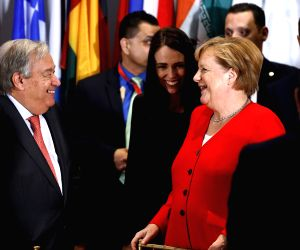 UNITED NATIONS, Sept. 25, 2019 - UN Secretary-General Antonio Guterres (L) speaks to German Chancellor Angela Merkel during a luncheon hosted by Antonio Guterres for the Heads of Delegation to the ...