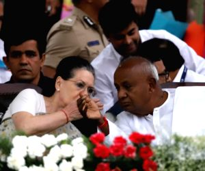 UPA Chairperson Sonia Gandhi in a conversation with JD-S chief H. D. Deve Gowda during the swearing-in ceremony of Karnataka Chief Minister H.D. Kumaraswamy, at Vidhana Soudha in Bengaluru ...
