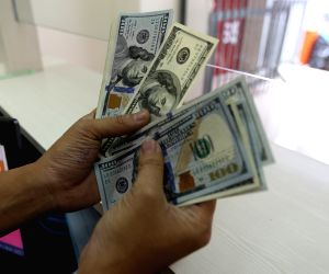 US dollar index edges down amid economic data