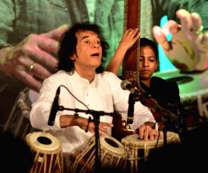 Zakir Hussain performs during a pogramme