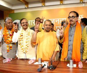 Uttar Pradesh Chief Minister Yogi Adityanath, Uttar Pradesh BJP chief Mahendra Nath Pandey and  Union Minister and BJP leader Piyush Goyal  celebrate with newly elected BJP Rajya Sabha members at ...