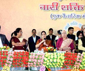 Uttar Pradesh Governor Ram Naik, Goa Governor Mridula Sinha, External Affairs Minister Sushma Swaraj and Mathura MP Hema Malini with Uttar Pradesh Ministers Srikant Sharma and Rita Bahuguna ...