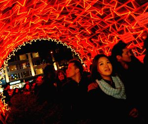 Vancouver (Canada): People attend the Christmas Lights of Hope charity initiative in Vancouver