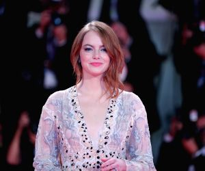 """VENICE (ITALY), Aug. 30, 2018 Actress Emma Stone attends the premiere of film """"The Favourite"""" at the 75th Venice International Film Festival in Venice, Italy, Aug. 30, 2018."""