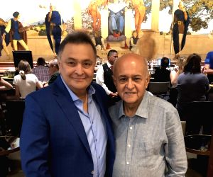 """Veteran actor Rishi Kapoor, in a latest picture, looks fitter and better. In a photograph posted on social media, he wrote: """"Such a joy to meet my old dear friend Amit Khanna. We at the King ..."""