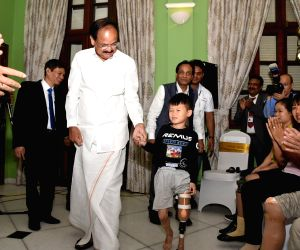 Vice President M. Venkaiah Naidu at the presentation ceremony of Jaipur Foot Artificial Limb Fitments under the 'India for Humanity' programme to commemorate 150 years of Mahatma Gandhi at Ho ...