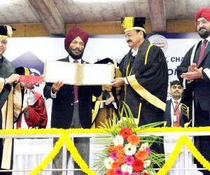 Vice President M. Venkaiah Naidu presents the Punjab University Khel Rattan Award to Padma Shree Milkha Singh, at the 67th Convocation of Panjab University in Chandigarh on March 4, 2018.