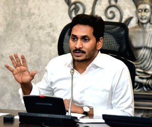 Vijayawada: Andhra Pradesh Chief Minister YS Jagan Mohan Reddy addresses during a review meeting in Vijayawada on July 16, 2019. (Photo: IANS)