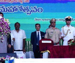 Vijayawada: Andhra Pradesh Governor E. S. L. Narasimhan administers the oath of office and secrecy to YSR Congress Party (YSRCP) President Y. S. Jagan Mohan Reddy as the Chief Minister of Andhra Pradesh, at Indira Gandhi Municipal Stadium in Vijayawa