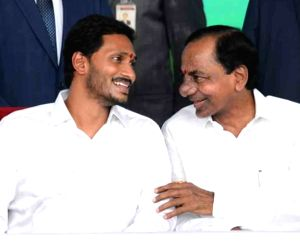 Vijayawada: Telangana Chief Minister K. Chandrashekhar Rao in a conversation with YSR Congress Party (YSRCP) President Y. S. Jagan Mohan Reddy at the latter's swearing-in as the Chief Minister of Andhra Pradesh, at Indira Gandhi Municipal Stadium in