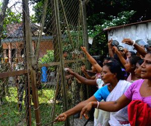Villagers of Diajijiry village protesting outside the office of  Assam Power Distribution Company Limited