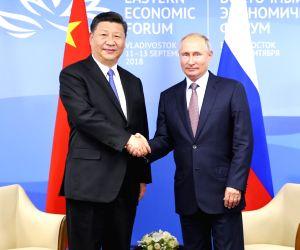 VLADIVOSTOK, Sept. 11, 2018 - Chinese President Xi Jinping (L) holds talks with Russian President Vladimir Putin in Vladivostok, Russia, Sept. 11, 2018.