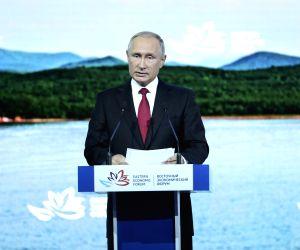 VLADIVOSTOK, Sept. 12, 2018 - Russian President Vladimir Putin addresses the plenary session of the fourth Eastern Economic Forum (EEF) held in Vladivostok in Russia's Far East, on Sept. 12, 2018.