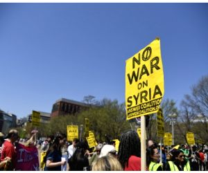 WASHINGTON, April 14, 2018 - People protest against U.S. strike on Syria outside the White House in Washington D.C., the United States, on April 14, 2018. The United States launched precise strike in ...