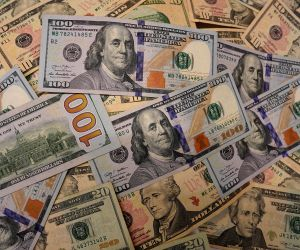 WASHINGTON, Aug. 1, 2019 (Xinhua) -- Photo taken on July 31, 2019 shows U.S. dollar banknotes in Washington D.C., the United States. U.S. Federal Reserve on Wednesday lowered interest rates for the first time since the 2008 global financial crisis, a